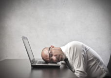 man-sleeping-on-laptop-image-from-shutterstock