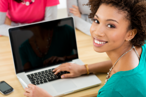 young-woman-in-front-of-macbook-image-from-shutterstock