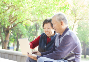 Image from Shutterstock, couple looking at laptop screen