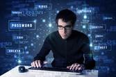 hacker-at-keyboard-with-identity-words-behind-image-from-shutterstock
